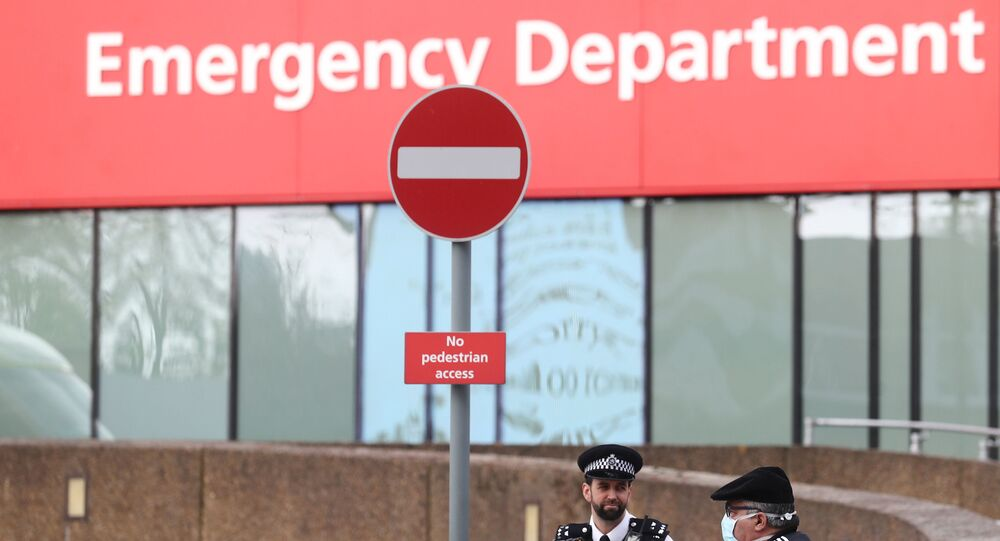 Police officers are seen outside St Thomas' Hospital after British Prime Minister Boris Johnson spent a second night in intensive care after his coronavirus (COVID-19) symptoms worsened on Monday. London, Britain, April 8, 2020.