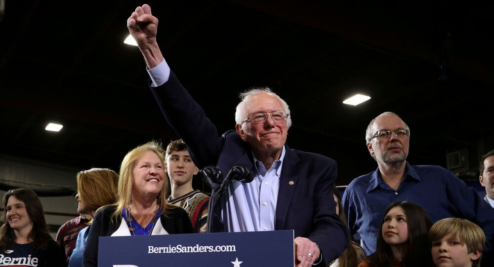 Democratic U.S. presidential candidate Senator Bernie Sanders is accompanied by his relatives, including his wife Jane, as he addresses supporters at his Super Tuesday night rally in Essex Junction, Vermont, U.S., March 3, 2020