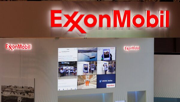 Logos of ExxonMobil are seen in its booth at Gastech, the world's biggest expo for the gas industry, in Chiba, Japan April 4, 2017 - Sputnik International