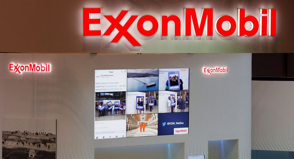 Logos of ExxonMobil are seen in its booth at Gastech, the world's biggest expo for the gas industry, in Chiba, Japan, 4 April 2017