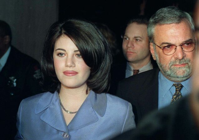 Monica Lewinsky and her attorney William Ginsburg leave a Washington restaurant in February 1998, weeks after the scandal breaks.
