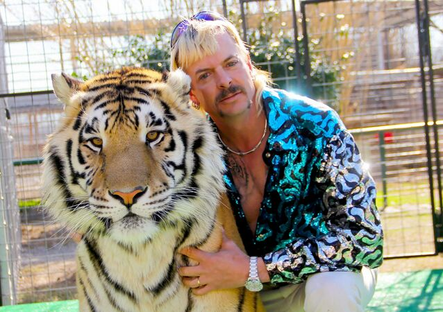 This undated photo courtesy of Netflix shows Joseph Joe Exotic Maldonado-Passage with one of his tigers
