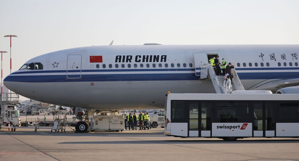 Members of an aid expedition in protective masks disembark from Air China plane carrying medical supplies donated by the Chinese government, in Athens, Greece, March 21, 2020. REUTERS/Alkis Konstantinidis