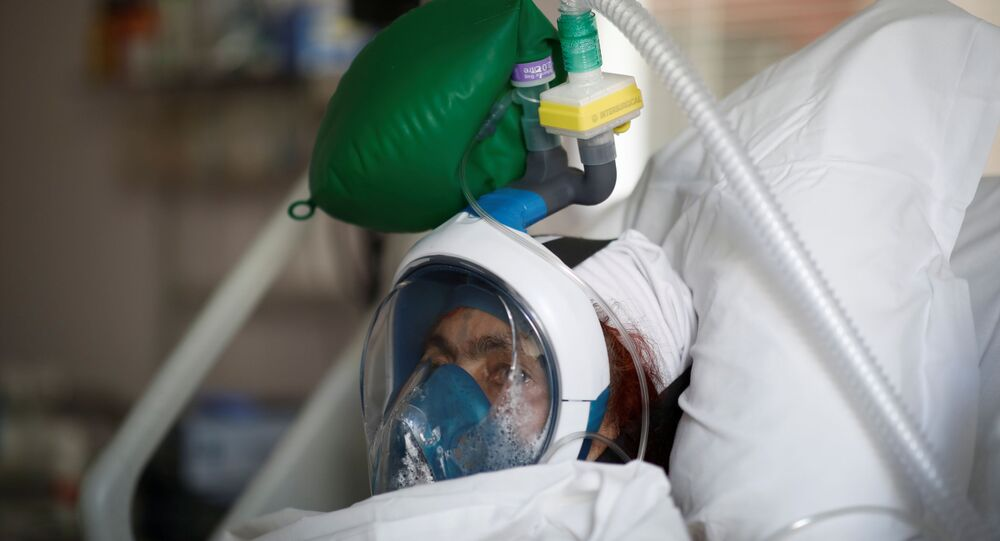 A patient suffering from coronavirus disease (COVID-19) wears a full-face Easybreath snorkelling mask given by sport chain Decathlon and turned into a ventilator for coronavirus treatment at the intensive care unit at Ambroise Pare clinic in Neuilly-sur-Seine near Paris, as the spread of the coronavirus disease continues in France, April 1, 2020.
