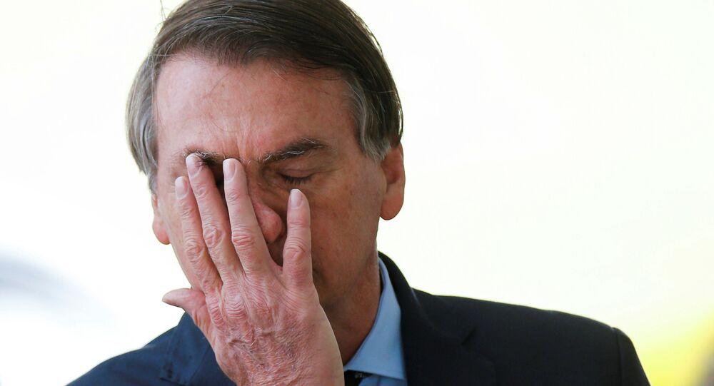 Brazil's President Jair Bolsonaro reacts while meeting supporters as he leaves Alvorada Palace, amid the coronavirus disease (COVID-19) outbreak, in Brasilia, Brazil, April 9, 2020.