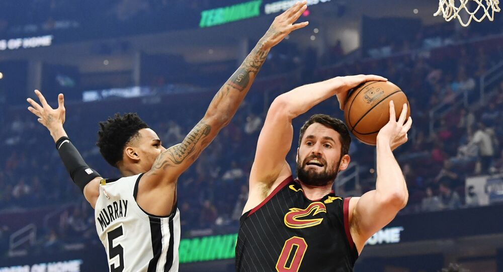 Mar 8, 2020; Cleveland, Ohio, USA; Cleveland Cavaliers forward Kevin Love (0) grabs a rebound from San Antonio Spurs guard Dejounte Murray (5) during the first half at Rocket Mortgage FieldHouse.