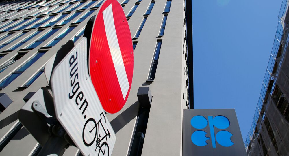 The logo of the Organization of the Petroleoum Exporting Countries (OPEC) and a traffic sign are seen outside of OPEC's headquarters in Vienna, Austria April 9, 2020