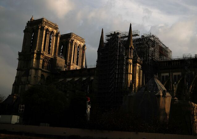 A view shows Notre Dame Cathedral, which was damaged in a devastating fire almost one year ago, in Paris ahead of Easter celebrations to be held under lockdown imposed to slow the spread of the coronavirus disease (COVID-19) in France, 7 April 2020.