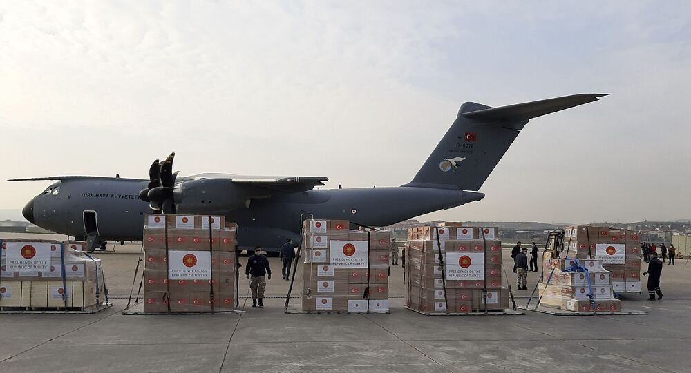 Soldiers prepare to load a military cargo plane with Personal Protection Equipment heading to Italy and Spain to help the countries combat the new coronavirus outbreak, in Ankara, Turkey, Wednesday, 1 April 2020. The new coronavirus causes mild or moderate symptoms for most people, but for some, especially older adults and people with existing health problems, it can cause more severe illness or death.
