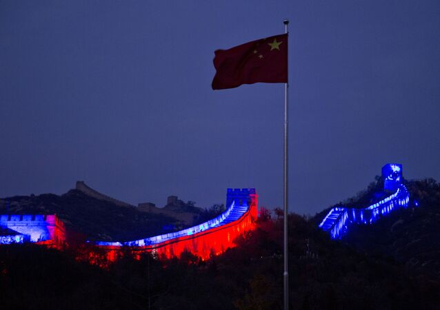 The Chinese national flag flies near a section of the Great Wall of China prepared to be lit by blue light to commemorate the 70th anniversary of the United Nations on the outskirts of Beijing, 24 October 2015. More than 200 iconic monuments, buildings, museums, bridges and other landmarks around the world were lighted up with blue - the official colour of the United Nations, to mark its 70th anniversary.