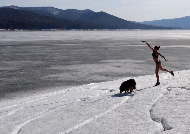 Yulia Boyarintseva, master of snowboarding and snowkiting sports, walks her dog near her home outside Krasnoyarsk