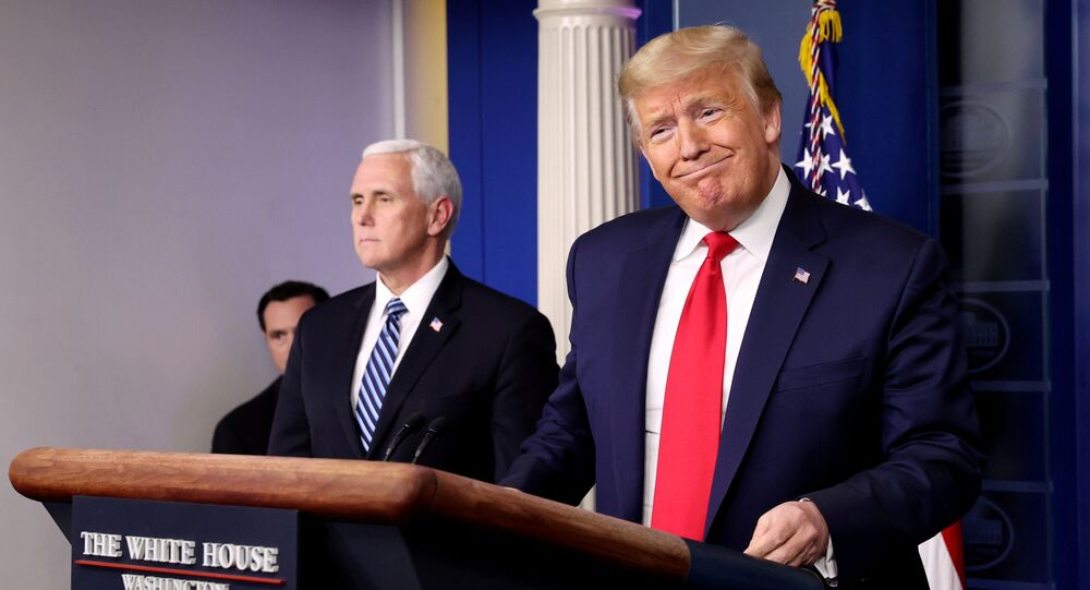 U.S. President Donald Trump arrives with Vice President Mike Pence to lead the daily coronavirus task force briefing at the White House in Washington, U.S., April 9, 2020