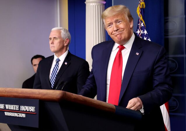 US President Donald Trump arrives with Vice President Mike Pence to lead the daily coronavirus task force briefing at the White House in Washington, US, 9 April 2020