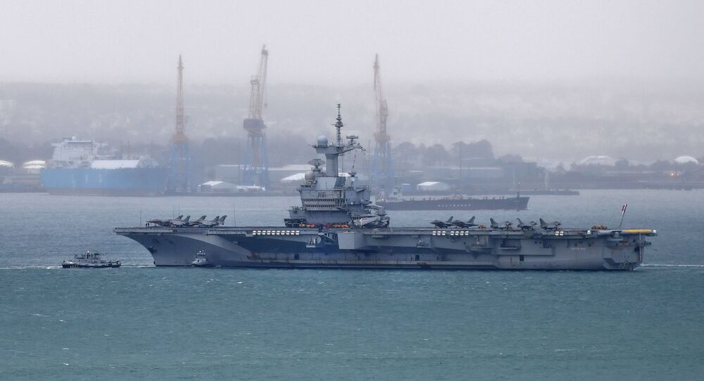A picture taken on March 13, 2020, shows the French aircraft carrier Charles de Gaulle as it enters the port of Brest, in western France.