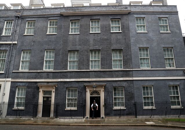 A Police officer is seen at the door of 10 Downing Street in London as the spread of the coronavirus disease (COVID-19) continues, London, Britain, April 6, 2020