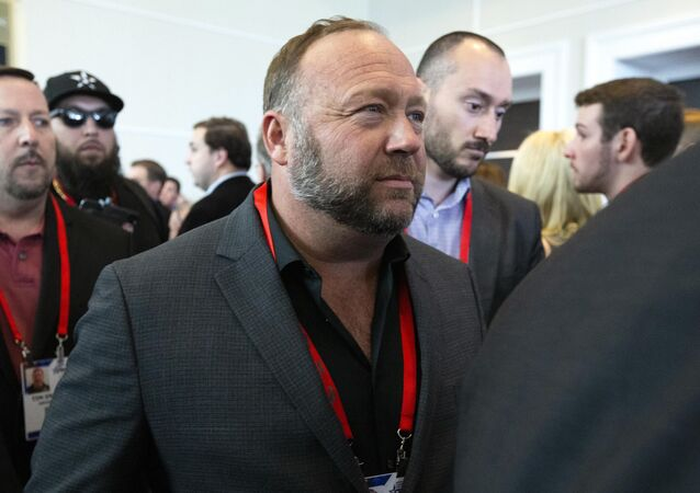 Conspiracy theorist Alex Jones walks at the Conservative Political Action Conference, CPAC 2020, at the National Harbor, in Oxon Hill, Md., Thursday, Feb. 27, 2020