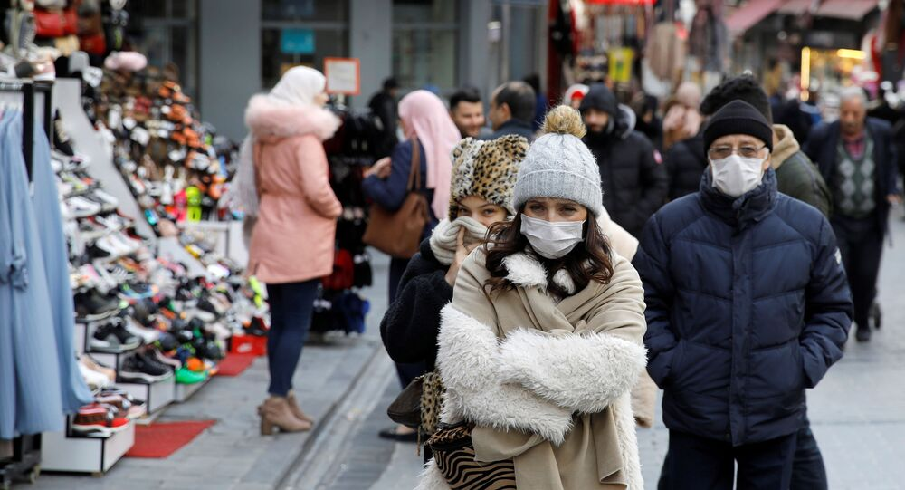 People wear protective face masks due to coronavirus concerns in Istanbul, Turkey March 16, 2020.