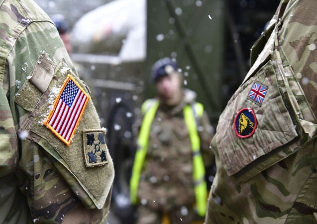 A British and an United States soldier stand side by side after a press conference on the military exercise 'Defender 2020' in Brueck, Germany, Wednesday, Feb. 26, 2020. The exercise with 37000 participants from a total of 18 nations will take place in Europe between January and about June 2020.