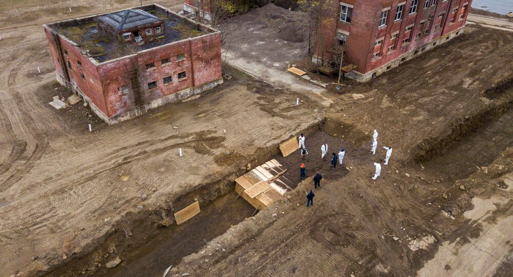 Drone pictures show bodies being buried on New York's Hart Island where the department of corrections is dealing with more burials overall, amid the coronavirus disease (COVID-19) outbreak in New York City, U.S., April 9, 2020.