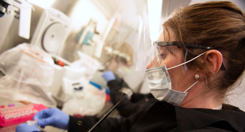 Kylene Karnuth, a clinical lab scientist, works with coronavirus samples as researchers begin a trial to see whether malaria treatment hydroxychloroquine can prevent or reduce the severity of the coronavirus disease (COVID-19), at the University of Minnesota in Minneapolis, Minnesota, U.S. March 19, 2020.