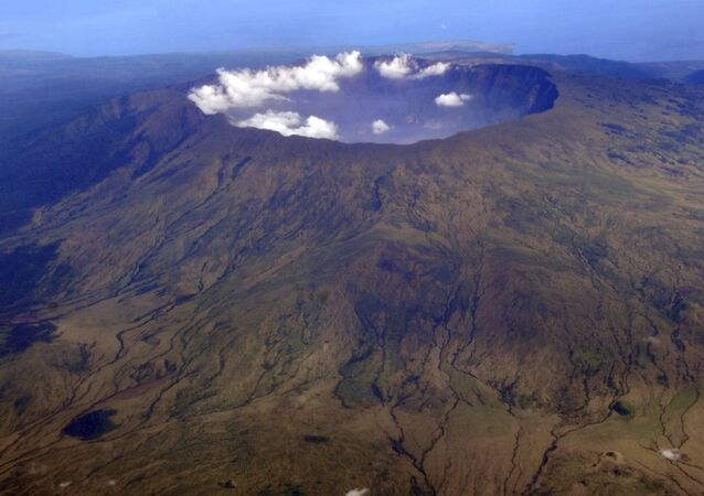 In this 19 October 2010 aerial photo, Mount Tambora's 10 kilometre-wide,1 kilometre-deep volcanic crater, created by the April 1815 eruption, is shown.