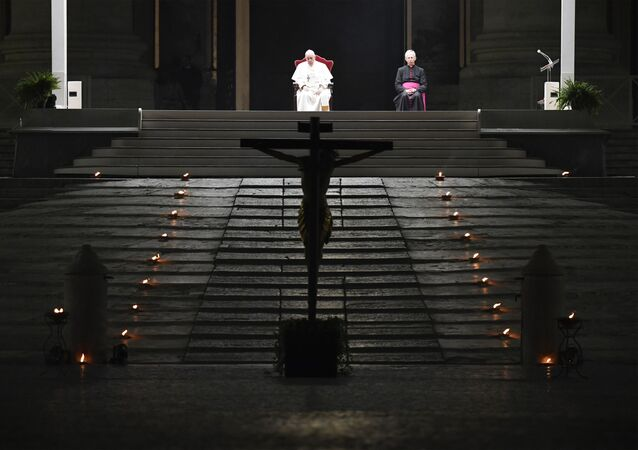 A photo taken and handout on April 10, 2020 by the Vatican Media shows Pope Francis presiding over Good Friday's Way of the Cross (Via Crucis) at St. Peter's Square in The Vatican on April 10, 2020, during the lockdown aimed at curbing the spread of the COVID-19 infection, caused by the novel coronavirus.