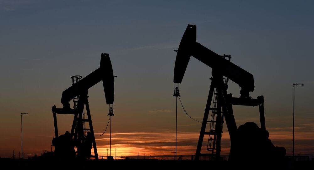 Pump jacks operate at sunset in an oil field in Midland, Texas U.S. August 22, 2018. Picture taken August 22, 2018