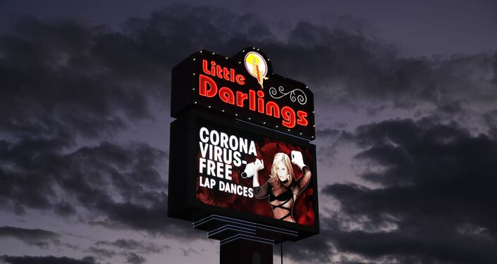 A sign at a strip club advertises coronavirus-free lap dances Friday, March 13, 2020, in Las Vegas.