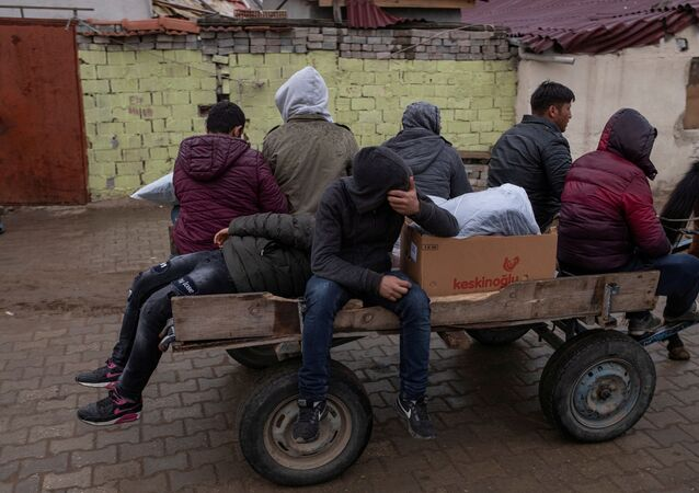 Migrants travel on a horse cart in Karaagac district near Turkey's Pazarkule border crossing with Greece's Kastanies, in Edirne, Turkey, March 10, 2020.