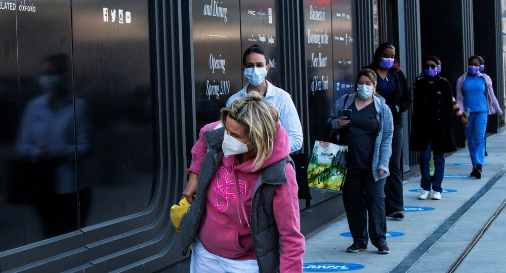 Health workers wait in line to get food near the Jacob K. Javits Convention Center, as the outbreak of the coronavirus disease (COVID-19) continues, in the Manhattan borough of New York City, New York, U.S., April 7, 2020.