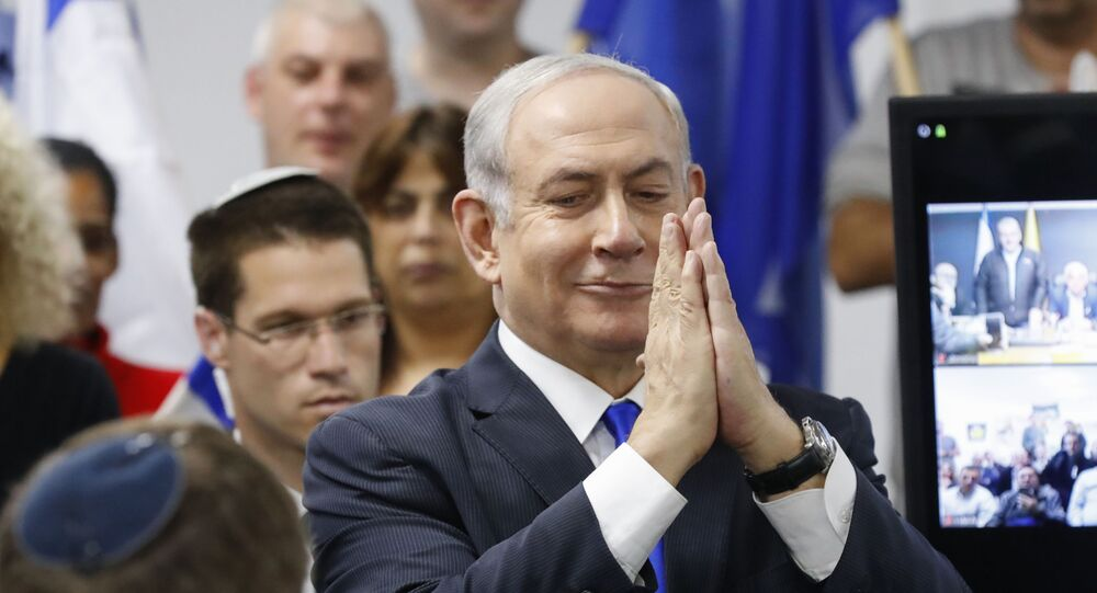 Israel's Prime Minister and leader of the Likud Party Benjamin Netanyahu gestures as he delivers a statement in the Israeli central city of Petah Tikva on March 7, 2020.