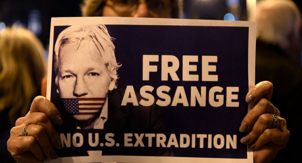 A demonstrator holds a sign during a protest called by Catalan National Assembly (ANC) under the motto Journalism is not a crime to support WikiLeaks founder Julian Assange in Barcelona on February 24, 2020.