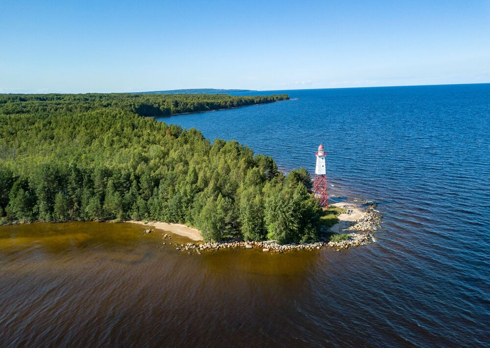 Sambo Lighthouse on Cape Cheynavolok, the easternmost part of the Leningrad Region, Russia. The height of the lighthouse was 23 meters, the visibility of the light was 10 nautical miles.