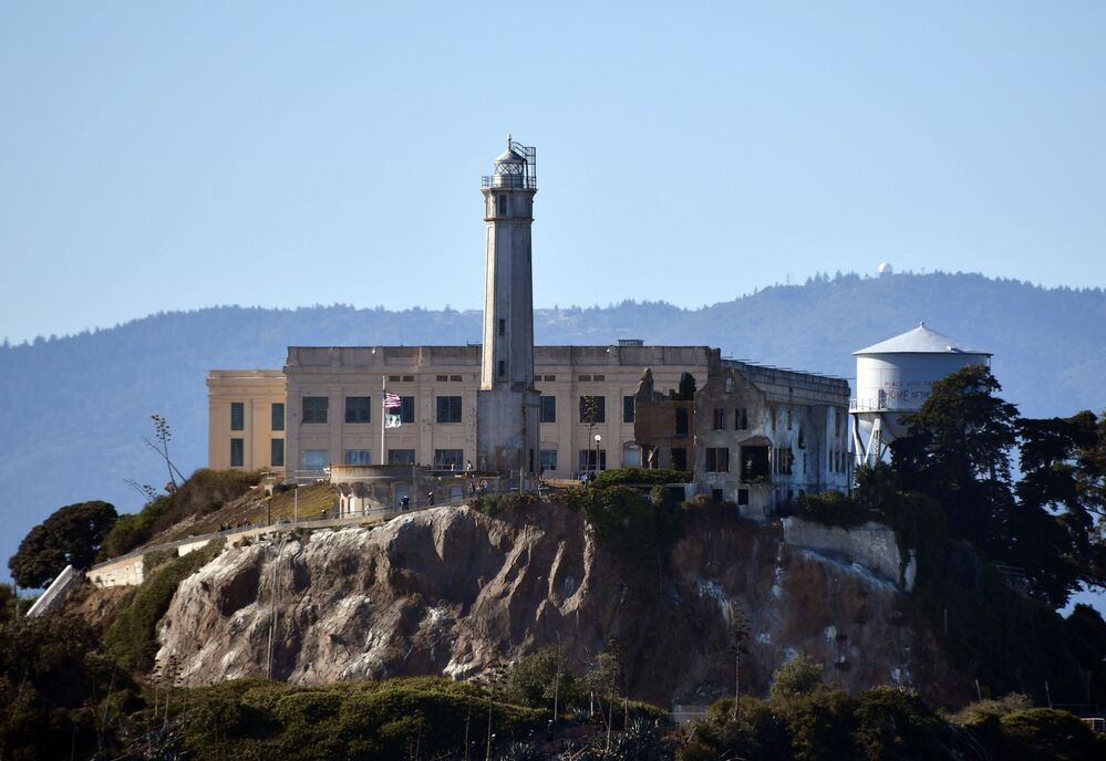 Alcatraz Island in San Francisco Bay. An abandoned prison is located on the island, where the oldest active lighthouse is located on the West Coast of the US.