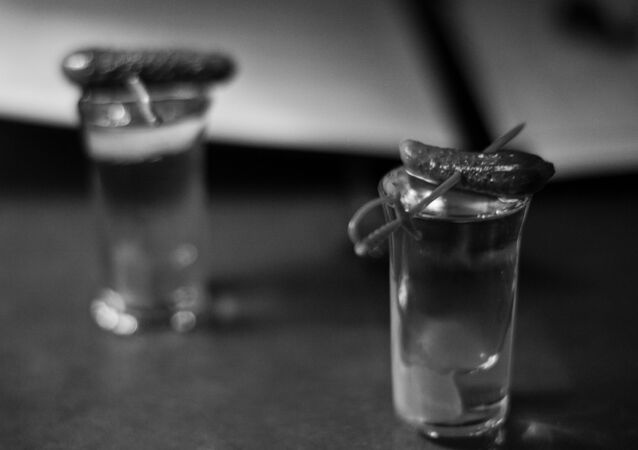 A shot of vodka with a pickle