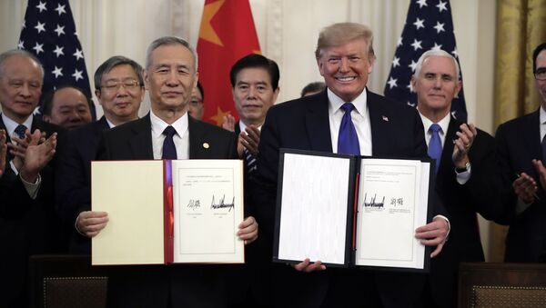 In this Wednesday, Jan. 15, 2020, file photo, U.S. President Donald Trump, right, signs a trade agreement with Chinese Vice Premier Liu He, in the East Room of the White House, in Washington - Sputnik International