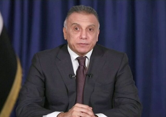 Iraq's designated prime minister Mustafa Al-Khadimi delivers his first televised speech after his nomination ceremony, in Baghdad, Iraq April 9, 2020, in this still image taken from video.