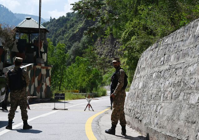Pakistani troops patrol at the Line of Control (LoC) --- the de facto border between Pakistan and India -- in Chakothi sector, in Pakistan-administered Kashmir on August 29, 2019.