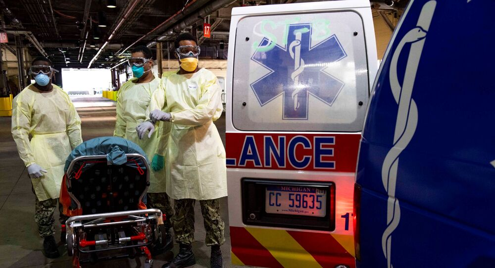 U.S. Navy Sailors prepare to transport a patient arriving for medical treatment from an ambulance onto the Military Sealift Command hospital ship USNS Comfort, supporting the local health network during the coronavirus disease (COVID-19) outbreak in New York City