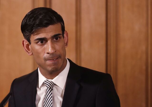 In this file photo dated Tuesday, March 17, 2020, Britain's Chancellor Rishi Sunak gives a press conference about the ongoing situation with the COVID-19 coronavirus outbreak inside 10 Downing Street in London.