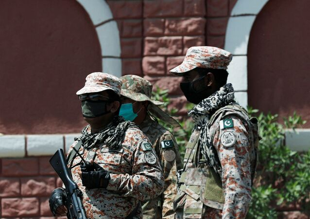Paramilitary soldiers stand guard outside a mosque, during a lockdown after Pakistan shut all markets, public places and discouraged large gatherings amid an outbreak of coronavirus disease (COVID-19), in Karachi, Pakistan April 3, 2020