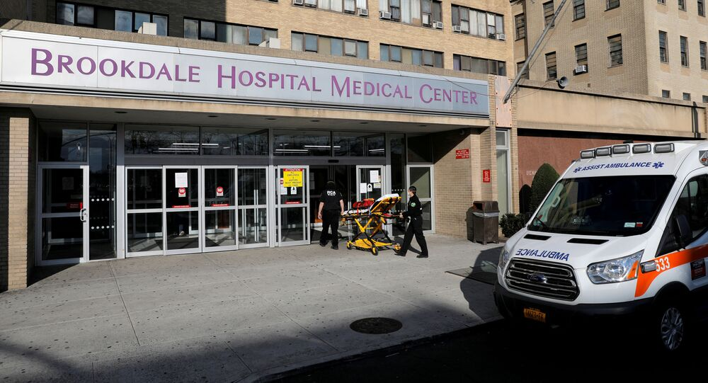 E.M.Ts wheel a bed into the Brookdale Hospital Medical Center during the coronavirus disease (COVID-19) outbreak in Brooklyn, New York City, New York, U.S., April 1, 2020