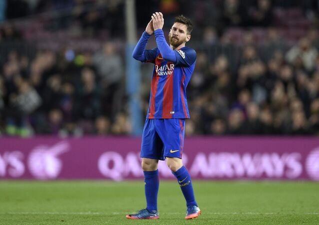 Barcelona's Argentinian forward Lionel Messi applauds as he leaves the pitch during the Spanish league football match FC Barcelona vs Real Sporting de Gijon at the Camp Nou stadium in Barcelona on March 1, 2017