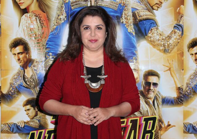 Director Farah Khan poses for photographers during a photo call for her film, Happy New Year-SLAM, at the Montcalm hotel in central London, Sunday, Oct. 5, 2014
