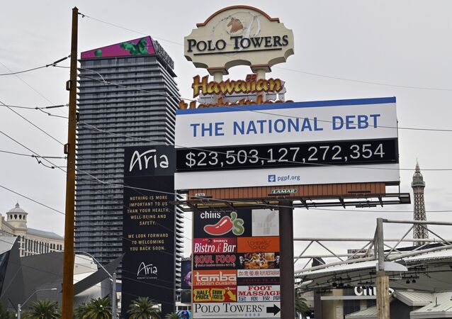 A billboard displaying the U.S. national debt is displayed along the Las Vegas Strip, Wednesday, March 18, 2020