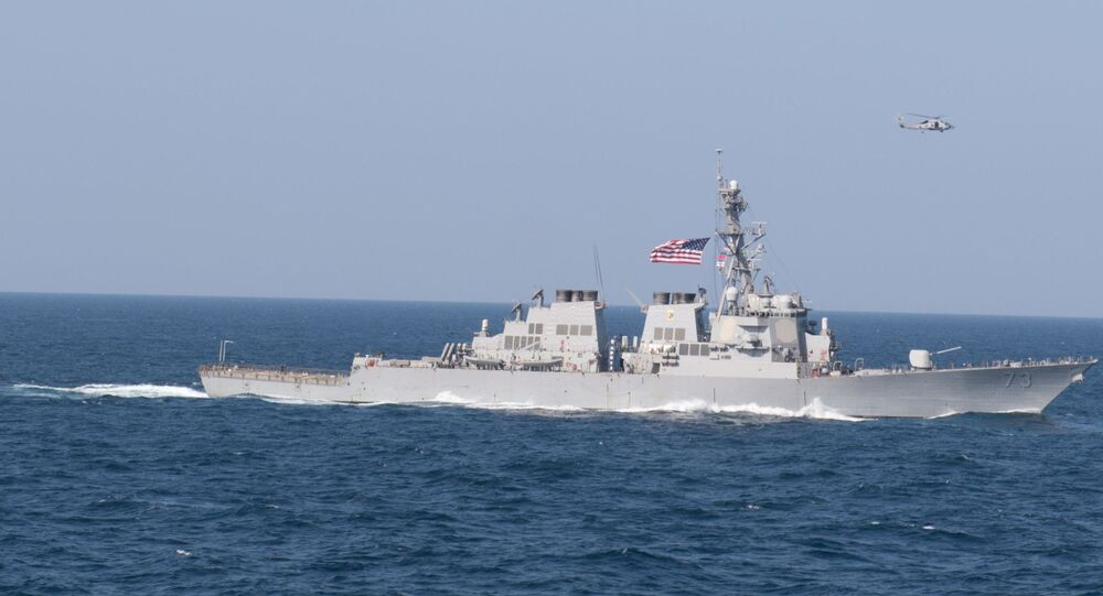 The guided-missile destroyer USS Decatur (DDG 73) sails in formation in the Arabian Sea, Dec. 14, 2018. The John C. Stennis Carrier Strike Group, Essex Amphibious Ready Group, and 13th Marine Expeditionary Unit are conducting integrated operations in the Arabian Sea to ensure stability and security in the Central Region, connecting the Mediterranean and the Pacific through the western Indian Ocean and three strategic choke points.