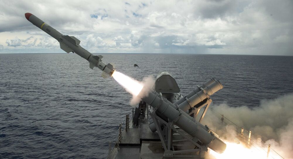 Harpoon missile launches from the missile deck of USS Coronado