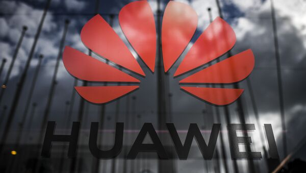 The logo of Chinese telecom giant Huawei is pictured during the Web Summit in Lisbon on November 6, 2019 - Sputnik International