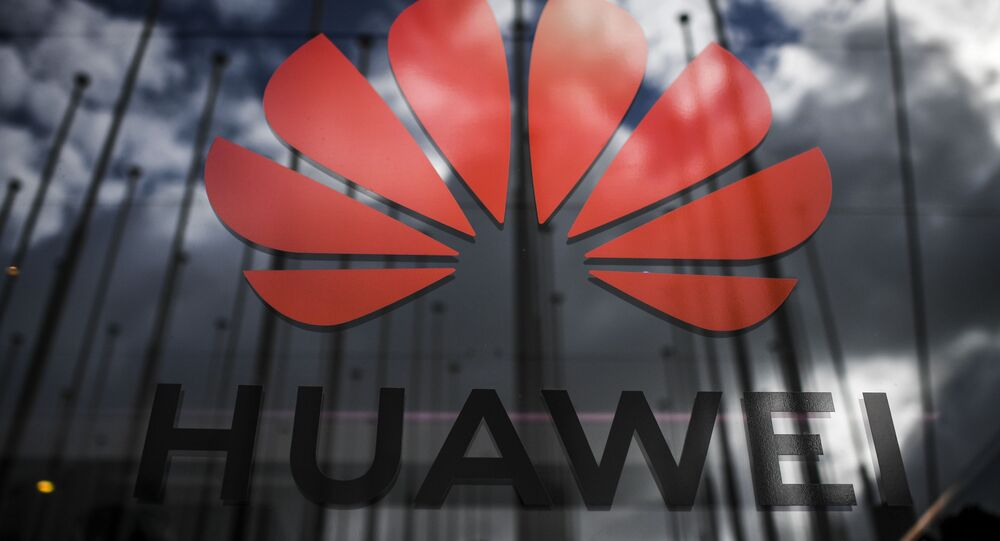 The logo of Chinese telecom giant Huawei is pictured during the Web Summit in Lisbon on November 6, 2019