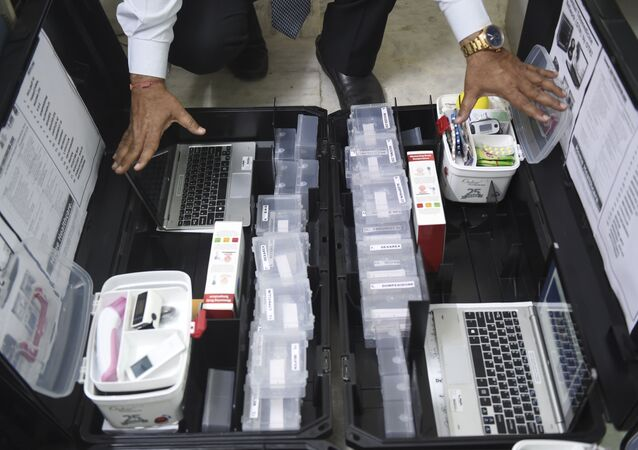 Scientist and founder of Online Telemedicine Research Institute, Ragesh Shah checks the contents of the kits prepared for the coronavirus scanning and surveillance system, in Ahmedabad on March 6, 2020.